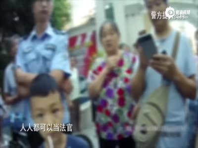 女子涉嫌盗窃被绑示众 警方欲带离遭市民阻止